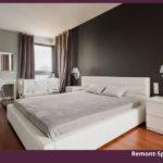 Интерьер спальни в сером цвете с белой мебелью